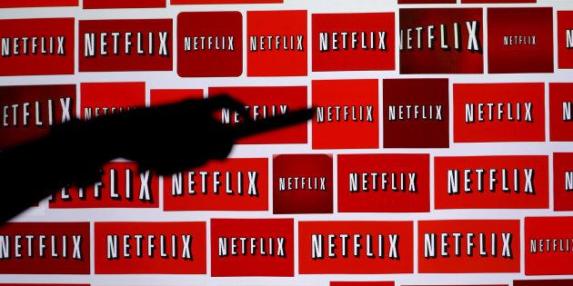 Suben acciones de Netflix por rumores de compra